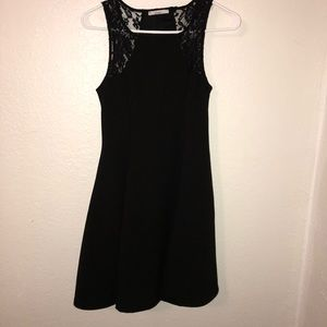 Wide bottom black dress with lace detail